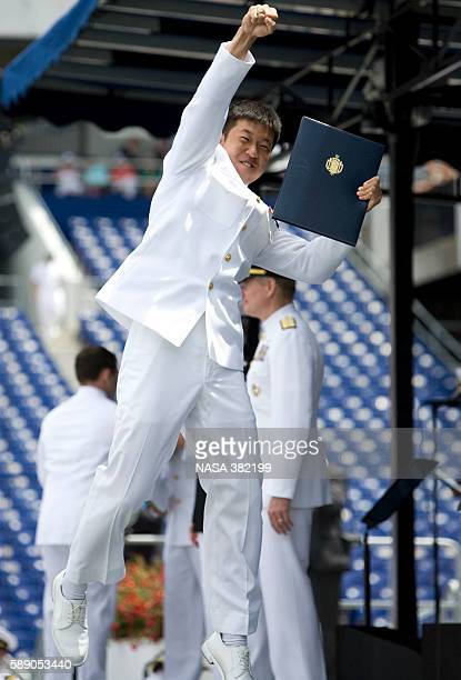 A member of the graduating class celebrates after receiving his diploma at the 2009 US Naval Academy Graduation