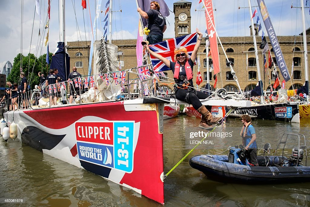 A member of the Great Britain yacht crew celebrates in Saint Katherine's Dock in London, England after taking the second position in the 2013-14 Clipper Round the World Yacht Race, on July 12, 2014. The world's longest ocean race began on September 1, 2013, with a 12-strong fleet visiting 14 ports on six continents and travelling 40,000 miles before returning to the British capital. AFP PHOTO/Leon Neal