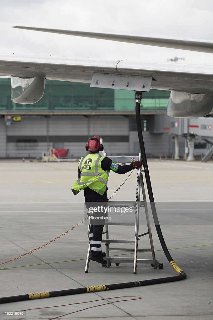 A member of the ground crew watches the re-fueling of a Ryanair Holdings Plc passenger aircraft at Stansted Airport, operated by Manchester Airports Group (MAG) in Stansted, U.K., on Tuesday, Sept. 10, 2013. From two planes in 1995, EasyJet has grown to more than 200 Airbus SAS aircraft carrying more than 59 million people annually, 20 million fewer than Ryanair. Photographer: Simon Dawson/Bloomberg via Getty Images