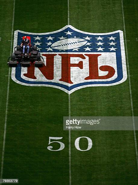 A member of the grounds crew mows the field in preparation of Super Bowl XLII at University of Phoenix Stadium on January 28 2008 in Glendale Arizona