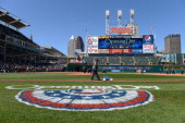 A member of the grounds crew paints the first base line prior to the start of the Opening Day game between the Cleveland Indians and the Toronto Blue...