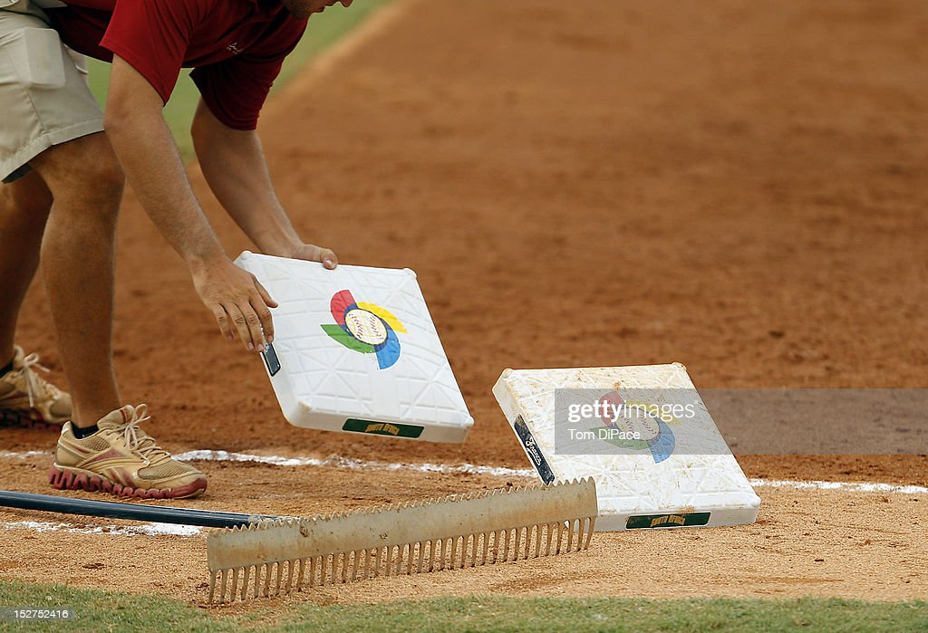 A member of the grounds crew replaces first base game 6 of the Qualifying Round of the World Baseball Classic at Roger Dean Stadium between Team Israel and Team Spain on September 23, 2012 in Jupiter, Florida.