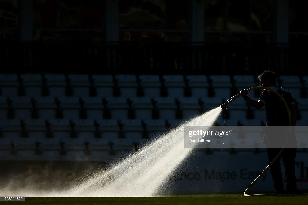 A member of the groundstaff waters the field after the Specsavers County Championship Division Two match between Sussex and Leicestershire at The 1st Central County Ground on May 4, 2016 in Hove, England.