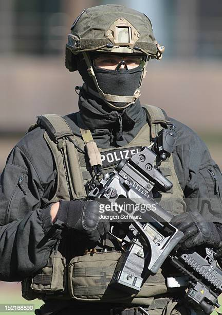 A member of the GSG 9 antiterrorism unit of the German Federal Police poses after a demonstration at a media event on September 14 2012 in Bonn...