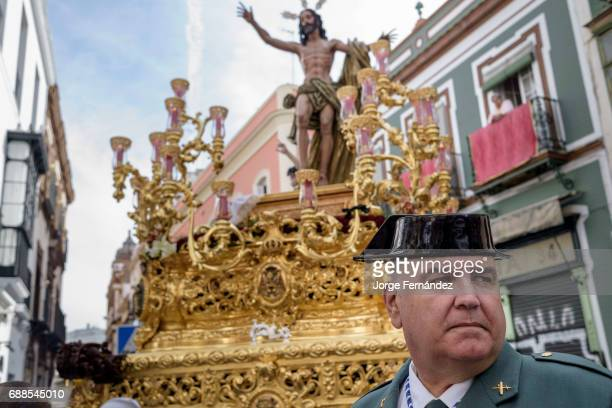Member of the Guardia Civil police corps in front of the image of Jesus Christ During the Easter week processions with the image of Christ and the...