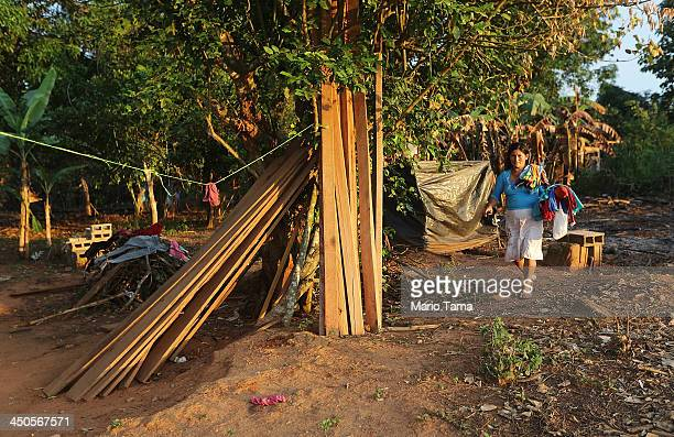 A member of the Guerra family walks in front of their home in a deforested section along the Interoceanic Highway in the Amazon lowlands on November...