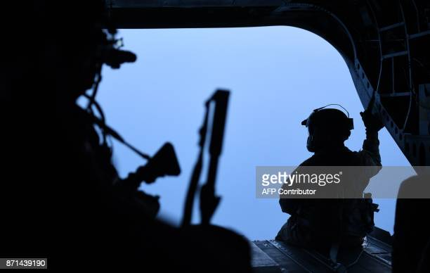 A member of the helicopter squadron accompanying US President Donald Trump looks on as they attempt to fly to the Demilitarized Zone over Seoul South...