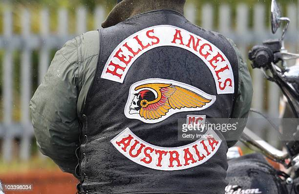 A member of the Hells Angels waits outside during the funeral for Melbourne crime figure Macchour Chaouk at Preston Mosque on August 16 2010 in...