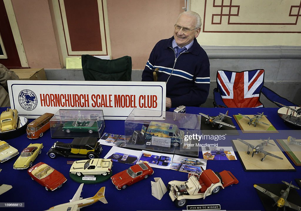 A member of the Hornchurch Scale Model Club sits at a table of model cars and aircraft The London Model Engineering Exhibition at Alexandra Palace on January 18, 2013 in London, England. The exhibition features more than a thousand models from over 50 national and regional clubs and societies. A wide range of locomotives, boats and aircraft are on show.
