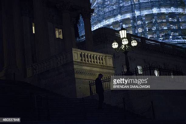 A member of the House of Representatives departs the US Capitol after a vote narrowly approving a $11 trillion ninemonth federal spending bill barely...