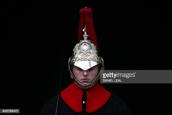 TOPSHOT A member of the Household Cavalry Mounted Regiment sits on his horse on duty on Whitehall in central London on February 25 2017 / AFP /...