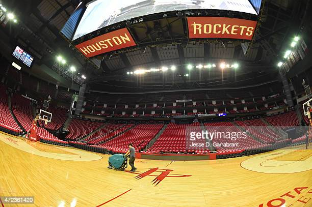 A member of the Houston Rockets cleaning staff prepares the floor prior to the game against the Los Angeles Clippers at the Toyota Center During Game...