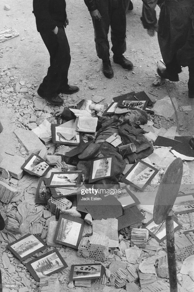 A member of the Hungarian secret police (AVH), lying dead in a Budapest gutter surrounded by Russian propaganda. Original Publication: Picture Post - 8730 - Hungary's Last Battle For Freedom - pub. 1956
