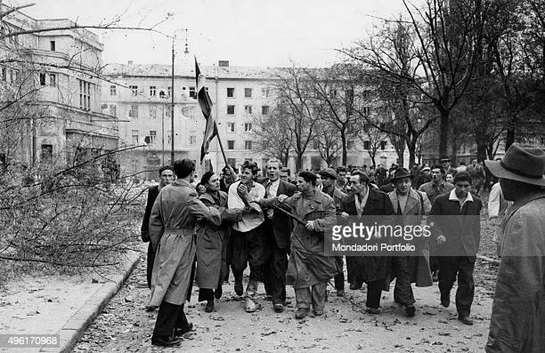 Member of the Hungarian secret police surrounded by the enraged crowd during the revolt of the Hungarian people against the Soviet tyranny Budapest...