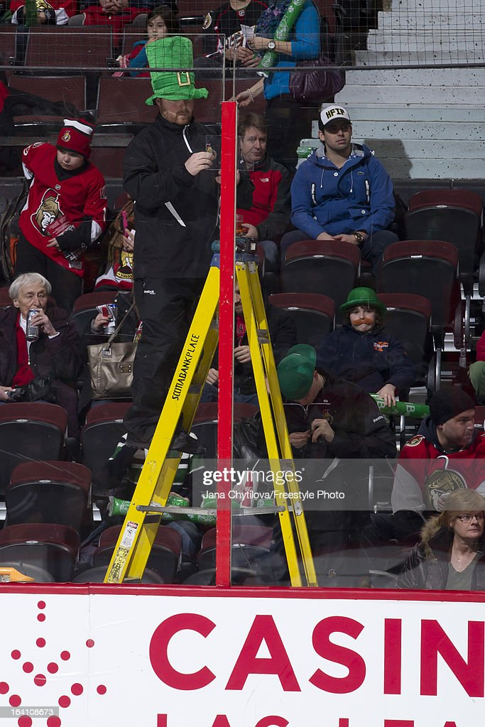 A member of the ice crew replaces a spacer at the top of the glass prior to the start of an NHL game between the Ottawa Senators and the Winnipeg Jets during an NHL game at Scotiabank Place on March 17, 2013 in Ottawa, Ontario, Canada.