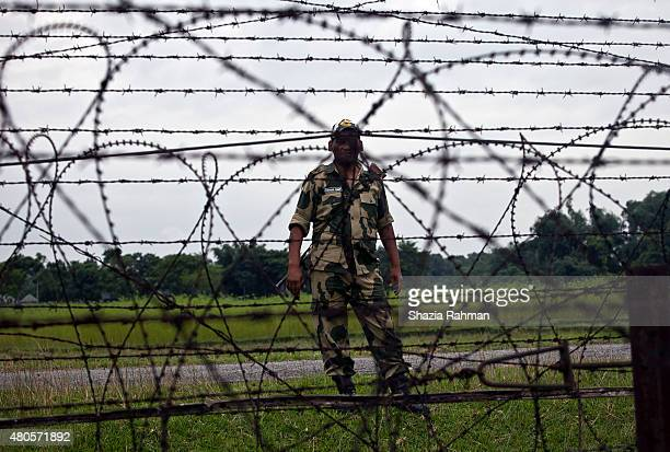 A member of the Indian BSF stands across from the India/Bangladesh border fence July 10 2015 in Lalmonirhat District Bangladesh The India Bangladesh...