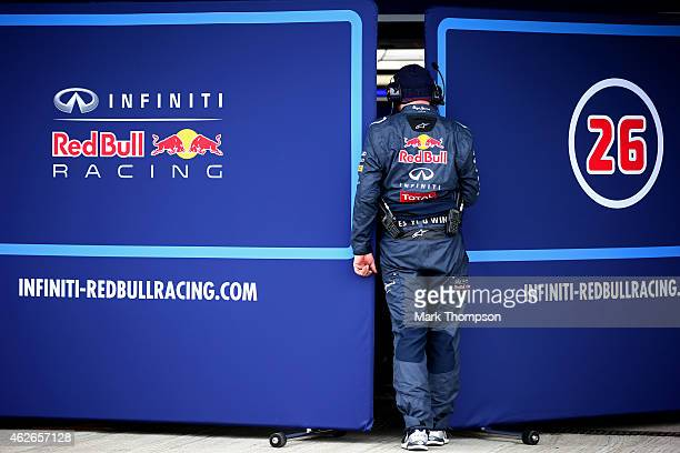 A member of the Infiniti Red Bull Racing team stands in between screens covering the exit of the garage into the pit lane during day two of Formula...