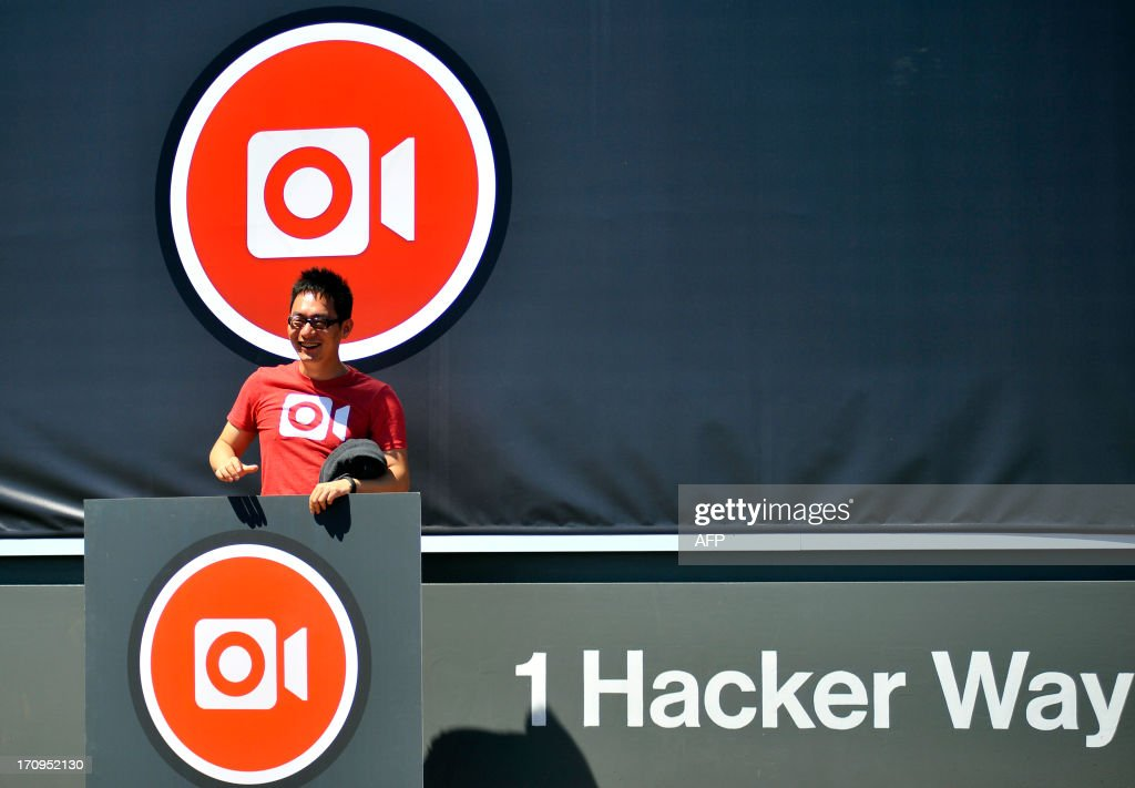 A member of the Instagram iOS Engineering team poses for a portrait near the Facebook sign at Facebook's corporate headquarters after a media event in Menlo Park, California, June 20, 2013. Facebook announced June 20th that it will add smartphone video-sharing to its Instagram photo-based social network, in a move that challenges Twitter's popular Vine service. Instagram video apps tailored for iPhones and smartphones powered by Google-backed Android software feature 13 filters for special effects and post to people's Facebook pages the same way pictures do, according to Systrom. AFP PHOTO / Josh Edelson
