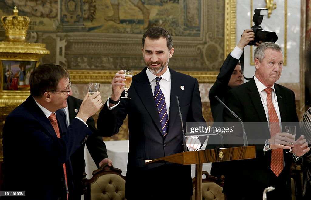 Member of the International Olympic Committee (IOC) and former French athlete Guy Drut (R), Spanish Crown Prince Felipe (C) and Swiss IOC manager director Gilbert Felli (L) attend an official dinner at the Royal Palace in Madrid on March 20, 2013. The president of Madrid's bid to host the 2020 Olympics, Alejandro Blanco said today he expects the Spanish capital will receive the highest technical score when the International Olympic Committee (IOC) Evaluation Commission publish their reports all three candidate cities. Tokyo and Istanbul are the other cities in the running for the 2020 Games with a final decision on the host city to be taken in Buenos Aires on September 7.