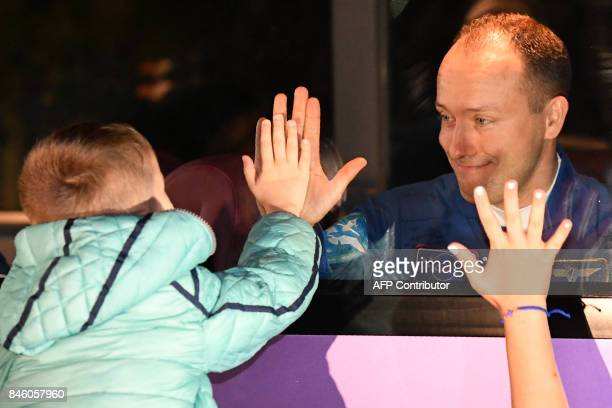 Member of the International Space Station expedition 53/54 Russia's cosmonaut Alexander Misurkin reacts near a bus during a sendingoff ceremony in...