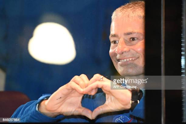 Member of the International Space Station expedition 53/54 US astronaut Mark Vande Hei reacts near a bus during a sendingoff ceremony in the...