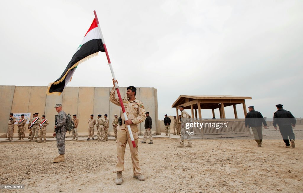A member of the Iraqi Army waves an Iraqi flag after a ceremony signing over Camp Adder, the last United States base in the country, to the Iraqi Air Force near Nasiriyah December 16, 2011. All U.S. troops were scheduled to have departed Iraq by December 31st, 2011. At least 4,485 U.S. military personnel died in service in Iraq. According to the Iraq Body Count, more than 100,000 Iraqi civilians have died from war-related violence.