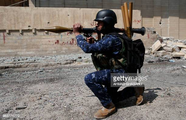 A member of the Iraqi federal police holds a rocket propelled grenade launcher as troops advance near the Old City in western Mosul on April 2 during...