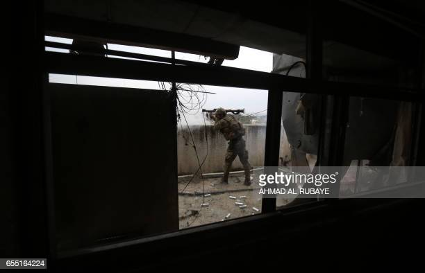 TOPSHOT A member of the Iraqi forces consisting of the Iraqi federal police and the elite Rapid Response Division fires a rocketpropelled grenade...