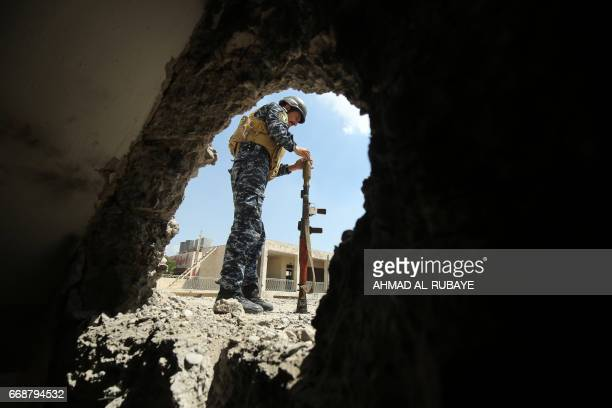 TOPSHOT A member of the Iraqi forces relaods a rocketpropelled grenade during clashes with Islamic State group fighters in the old city of Mosul on...