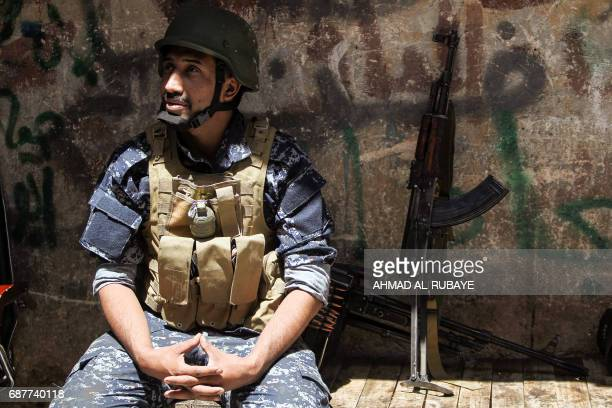 A member of the Iraqi forces takes a break near the frontline in the old city of Mosul on May 24 during the ongoing offensive to retake the area from...