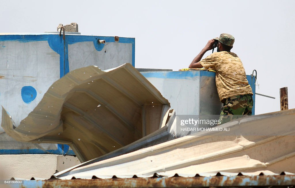 A member of the Iraqi government forces keeps watch in Fallujah, 50 kilometres (30 miles) from the capital Baghdad, after forces retook the embattled city from the Islamic State group on June 26, 2016. Iraqi Prime Minister Haider al-Abadi urged all Iraqis to celebrate the recapture of Fallujah by the security forces and vowed the national flag would be raised in Mosul soon. While the battle has been won, Iraq still faces a major humanitarian crisis in its aftermath, with tens of thousands of people who fled the fighting desperately in need of assistance in the searing summer heat. ALI