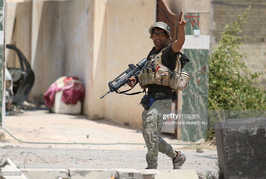 A member of the Iraqi government forces patrols an area of Fallujah after troops retook the embattled city from the Islamic State group on June 26, 2016. Iraqi Prime Minister Haider al-Abadi urged all Iraqis to celebrate the recapture of Fallujah by the security forces and vowed the national flag would be raised in Mosul soon. While the battle has been won, Iraq still faces a major humanitarian crisis in its aftermath, with tens of thousands of people who fled the fighting desperately in need of assistance in the searing summer heat. ALI