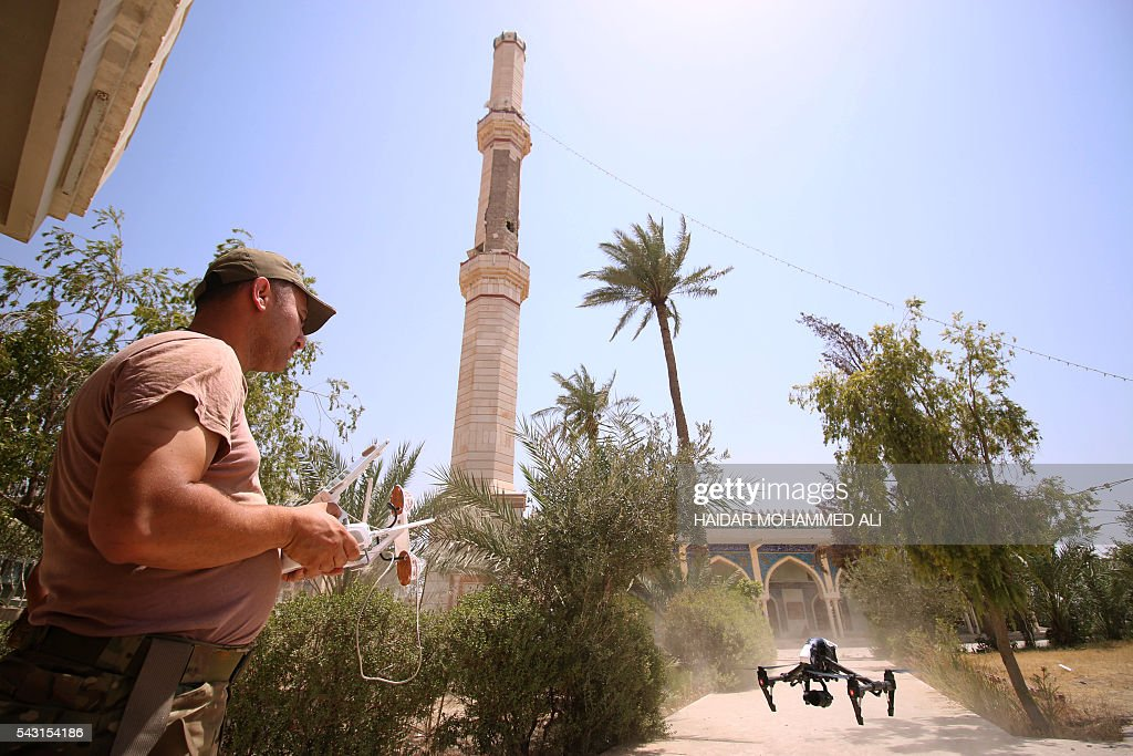 A member of the Iraqi government forces uses a drone in Fallujah, 50 kilometres (30 miles) from the capital Baghdad, after forces retook the embattled city from the Islamic State group on June 26, 2016. Iraqi Prime Minister Haider al-Abadi urged all Iraqis to celebrate the recapture of Fallujah by the security forces and vowed the national flag would be raised in Mosul soon. While the battle has been won, Iraq still faces a major humanitarian crisis in its aftermath, with tens of thousands of people who fled the fighting desperately in need of assistance in the searing summer heat. ALI