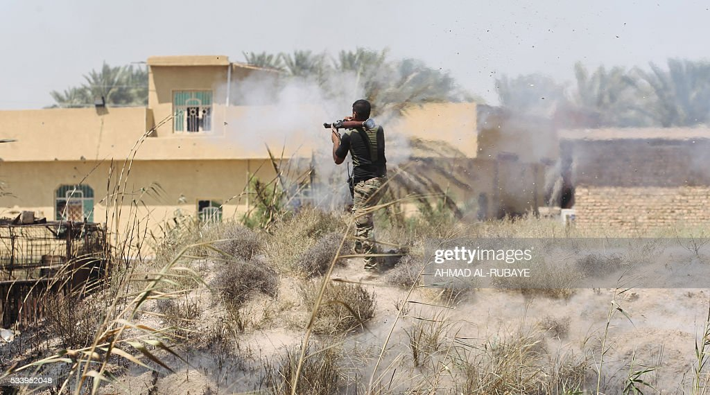 A member of the Iraqi pro-government forces fires a rocket-propelled grenade launcher during an operation in al-Shahabi village, east of Fallujah, in an operation to retake the city from Islamic State (IS) group, on May 24, 2016. Iraqi forces cleared areas around Fallujah on May 24 after launching an assault to retake the city, tightening their siege on Islamic State group fighters. With the jihadists surrounded and outnumbered, the recapture of their iconic bastion looked ultimately inevitable, especially after IS suffered a string of losses in recent months. / AFP / AHMAD
