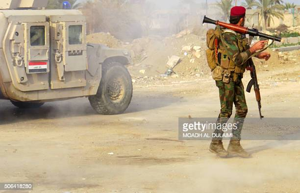 A member of the Iraqi progovernment forces holds a position as they continue to advance with the support of USled coalition air strikes towards...
