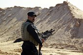 A member of the Iraqi security forces patrols the Najaf governorates border with the mostly Islamic State group controlled western province of Anbar...