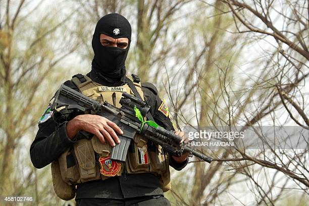 A member of the Iraqi special forces looks on in the Jurf alSakhr area north of the Shiite shrine city of Karbala on October 30 after they retook the...