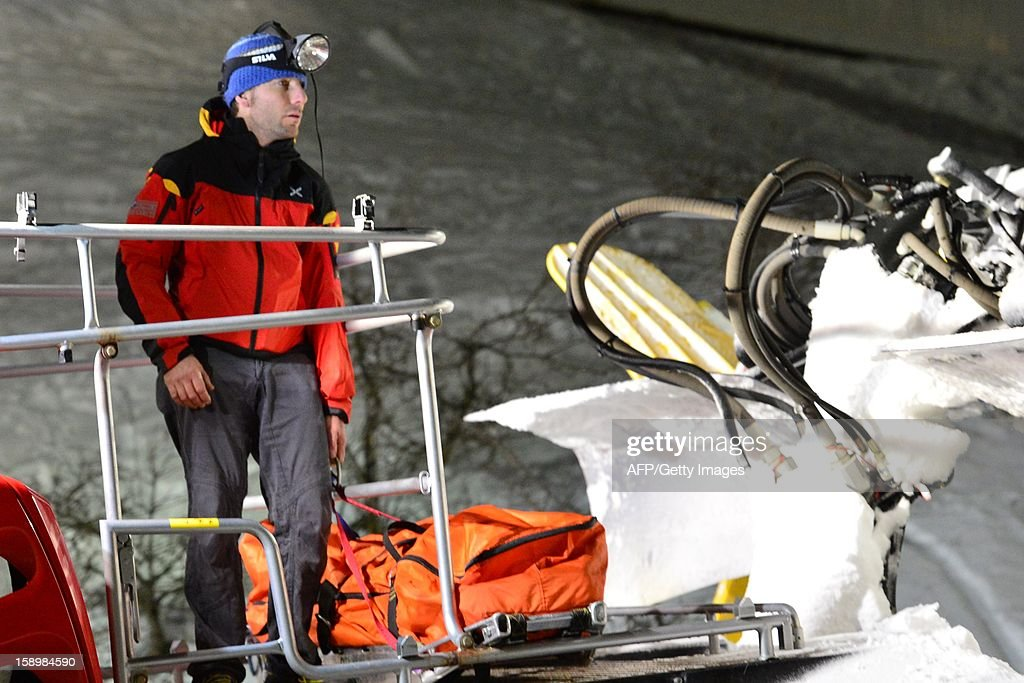 A member of the Italian Alpine rescue team stands near the body of one of the six Russian tourists who perished after an accident in Mount Cermis, near Cavalese in Val di Fiemme, on January 5, 2013. A snowmobile accident in the Italian Alps left six tourists dead and two others seriously injured. The eight -- all from eastern Europe, or Russia -- were riding on the vehicle across an unlit slope on Mount Cermis in the Trento region, rescuers said. Mount Cermis was the scene of two deadly cable car accidents in 1976 and 1998. In the latter a US military plane cut a cable supporting a gondola of an aerial tramway.
