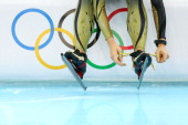 A member of the Japan speed skating team prepares to practise on the ice during a training session ahead of the Sochi 2014 Winter Olympics at Adler...