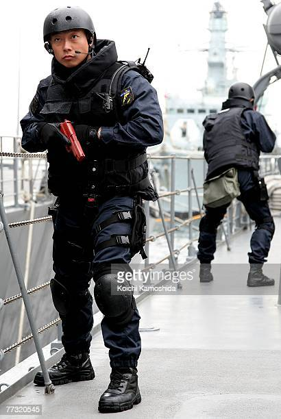 A member of the Japanese Navy searches a suspicious ship during the Proliferation Security Initiative Maritime Interdiction Exercise 'Pacific Shield...