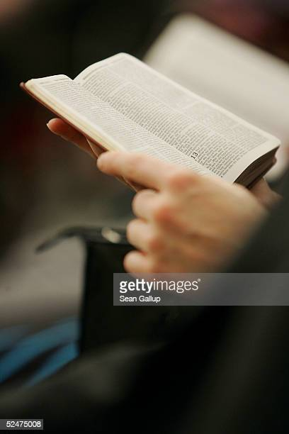 A member of the Jehova's Witnesses Church reads a Bible during a religious service March 24 2005 in Hennigsdorf Germany just outside of Berlin A...