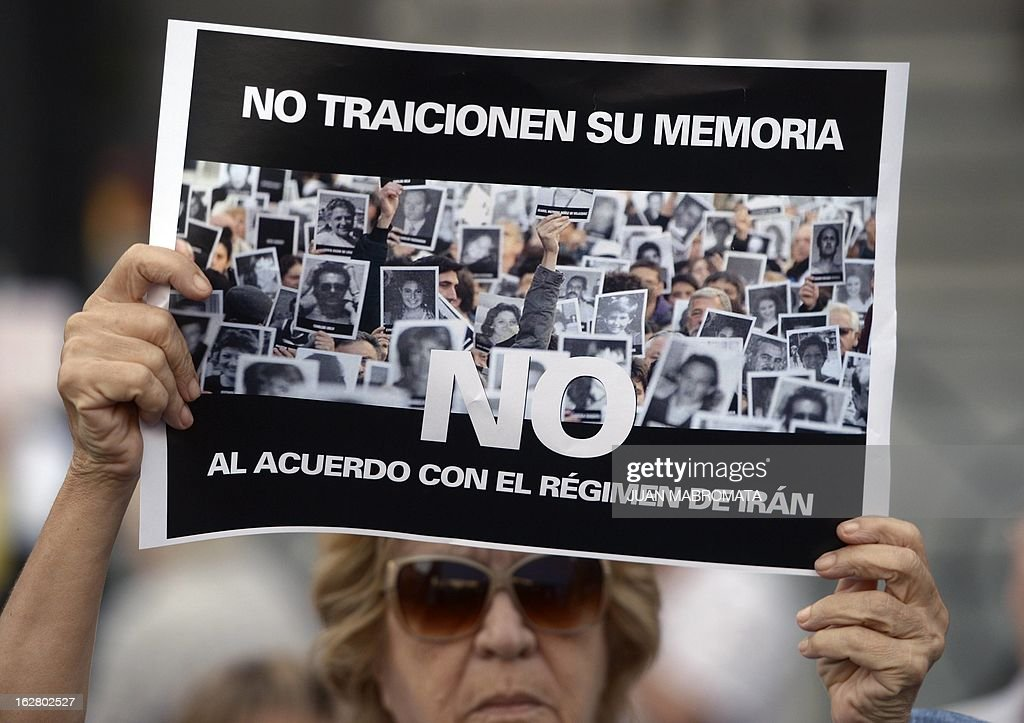 A member of the Jewish community holds a sign reading 'Don't betray your memory. No to the agreement with Iran's regime', outside the Congress building in Buenos Aires on February 27, 2013, while legislatives discuss the possibility of an agreement with Iran to establish a truth commission over a terrorist attack that took place in 1994. Eight Iranian nationals are still wanted in connection with the bombing of the Argentine Israelite Mutual Association (AMIA is Spanish), which left 85 dead and 300 wounded. AFP PHOTO / Juan Mabromata