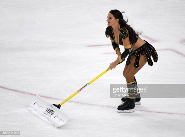 A member of the Knights Crew cleans the ice during the Vegas Golden Knights' inaugural regularseason home opener against the Arizona Coyotes at...