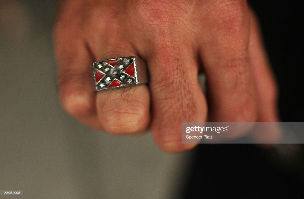 A member of the Ku Klux Klan displays a ring with the confederate flag during the 11th Annual Nathan Bedford Forrest Birthday march July 11, 2009 in Pulaski, Tennessee. With a poor economy and the first African-American president in office, there has been a rise in extremist activity in many parts of America. According to the Southern Poverty Law Center in 2008 the number of hate groups rose to 926, up 4 percent from 2007, and 54 percent since 2000. Nathan Bedford Forrest was a lieutenant general in the Confederate Army during the American Civil War and played a role in the postwar establishment of the first Ku Klux Klan organization opposing the reconstruction era in the South.