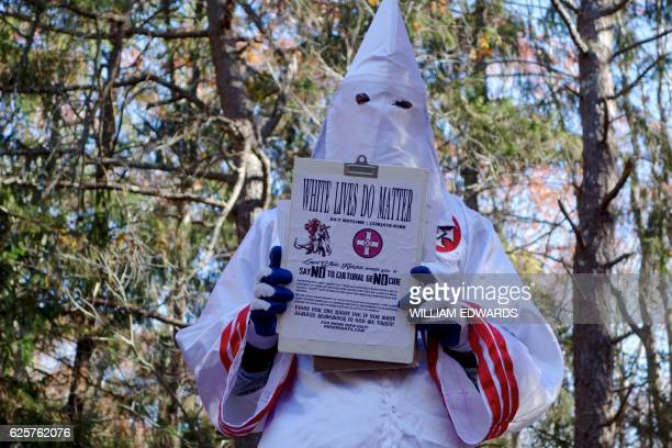 A member of the Ku Klux Klan who says his name is Gary Munker poses for a photo during an interview with AFP in Hampton Bays New York on November 22...