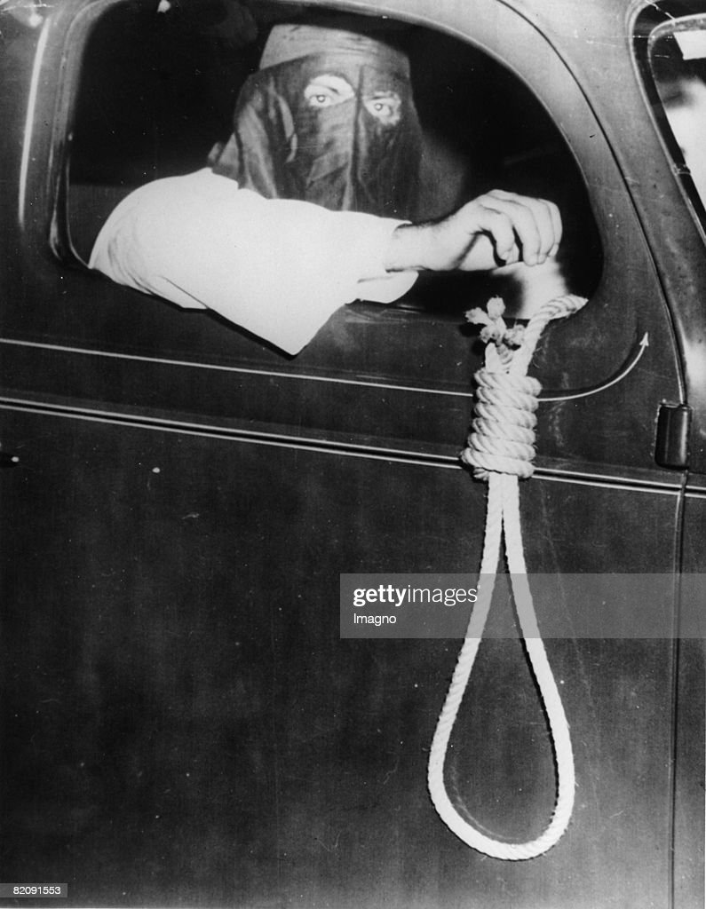 Member of the Ku Klux Klan with a noose 75 cars of the Ku Klux Klan were driving through Miami Florida to hold off black people form the election...
