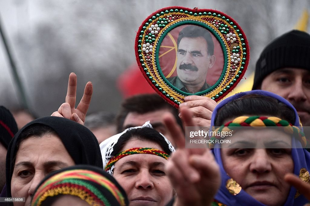 A member of the Kurdish community holds aloft a portrait of convicted Kurdistan Worker's Party (PKK) leader <a gi-track='captionPersonalityLinkClicked' href=/galleries/search?phrase=Abdullah+Ocalan&family=editorial&specificpeople=658599 ng-click='$event.stopPropagation()'>Abdullah Ocalan</a> during a demonstration calling for Ocalan's release in Strasbourg, Eastern France, on February 14, 2015. Ocalan was captured by Turkish undercover agents in Kenya in 1999, brought back to Turkey and sentenced to death. His sentence was later commuted to life.
