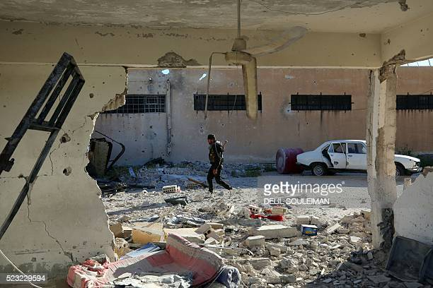 A member of the Kurdish internal security forces inspects the Alaya prison in the northeastern Syrian city of Qamishli on April 22 2016 Syrian...