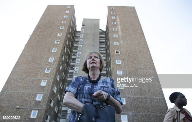 Member of the Labour Party and MP for Camberwell and Peckham Harriet Harman walks in front of a tower block after holding a press conference outside...