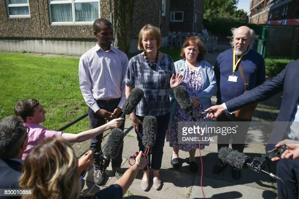 Member of the Labour Party and MP for Camberwell and Peckham Harriet Harman is accompanied by residents as she speaks during a press conference in...